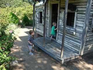 Andrew and Isaac exploring a cabin